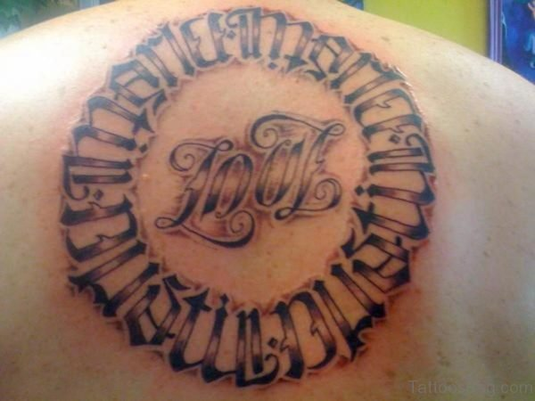 Ambigram Circle Tattoo On Upper Back