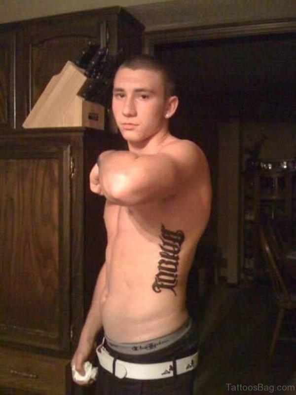Ambigram Tattoo On Man Rib Side