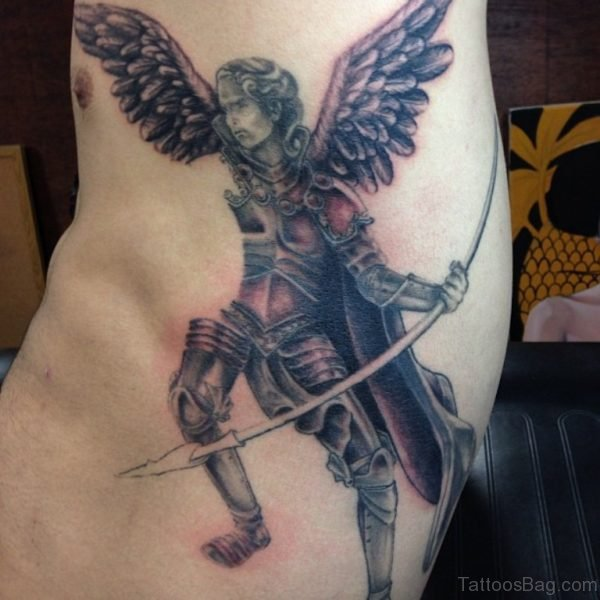 Angel With Long Arrow Tattoo On Rib