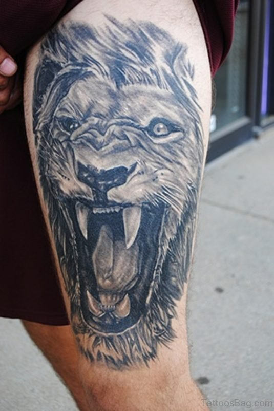 Angry Lion Tattoo On Thigh
