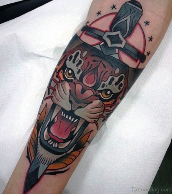 Angry Tiger With Dagger Tattoo On Arm