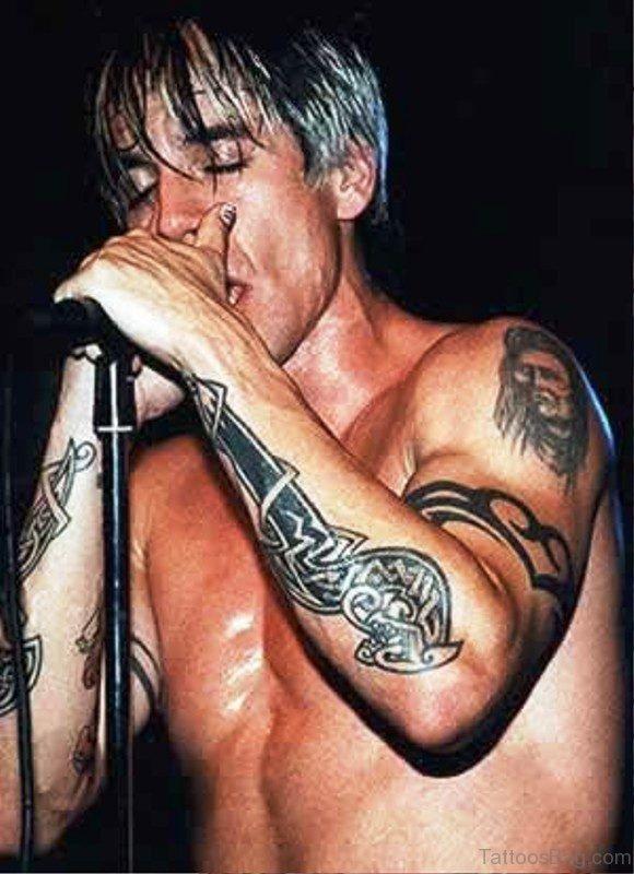 Anthony Kiedis Dagger Tattoo On Arm
