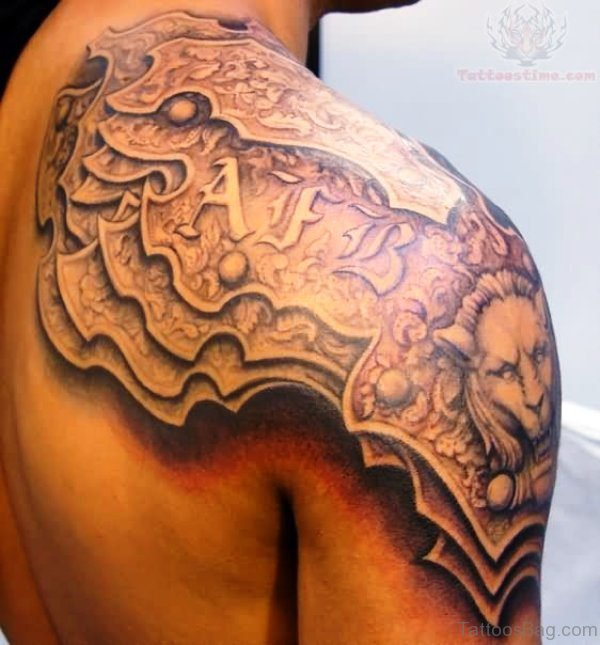 Armour On Right Shoulder Tattoo