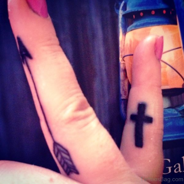 Arrow And Cross Tattoos On Fingers
