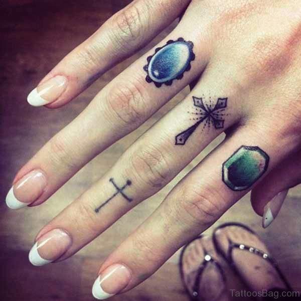 Arrow With Cross Tattoo Design