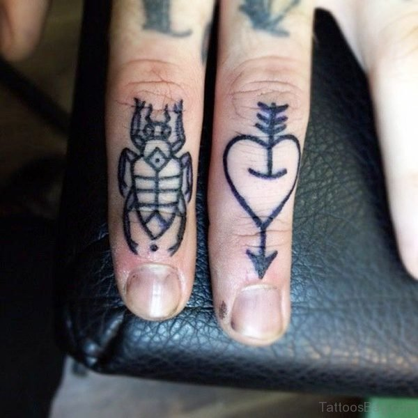 Arrow With Heart Tattoo On Finger