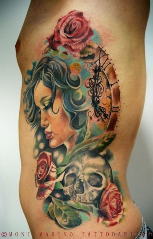 Asian Woman With Skull Roses Tattoo On Rib Side