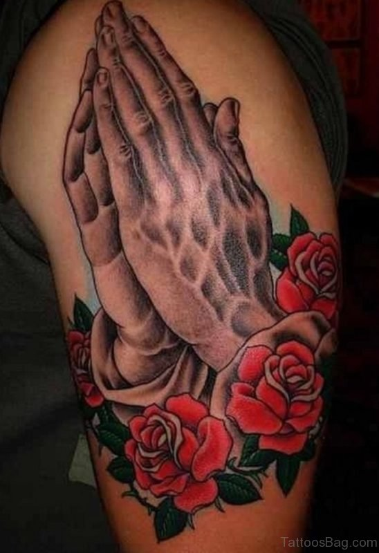 Attarctive Rose And Praying Hands Tattoo