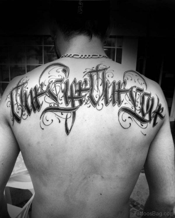 Attractive Ambigram Tattoo On Upper Back