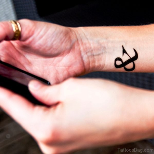 Attractive Ampersand Wrist Tattoo