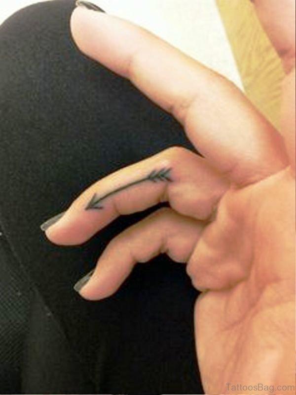 Attractive Arrow Tattoo On Finger