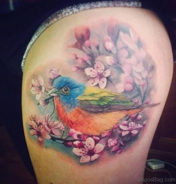 Attractive Bird And Aqua Flower Tattoo On Thigh