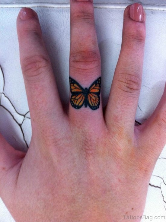 Attractive Butterfly Tattoo In Finger