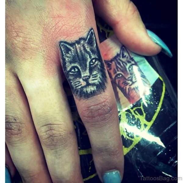 Attractive Cat Tattoo On Finger
