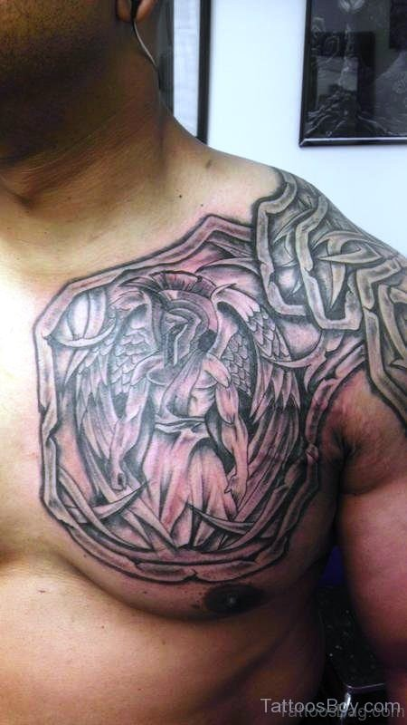 Attractive Chest And Shoulder Armour Tattoo