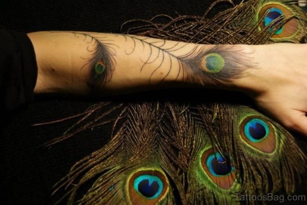 Attractive Peacock Feather Wrist Tattoo