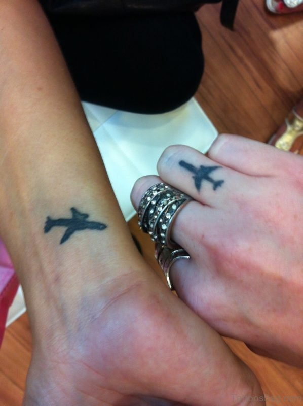 Attractive Plane Tattoo On Wrist