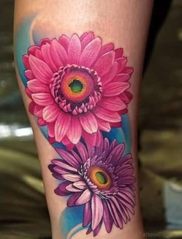 Attractive Two Daisy Flower Tattoo On Leg