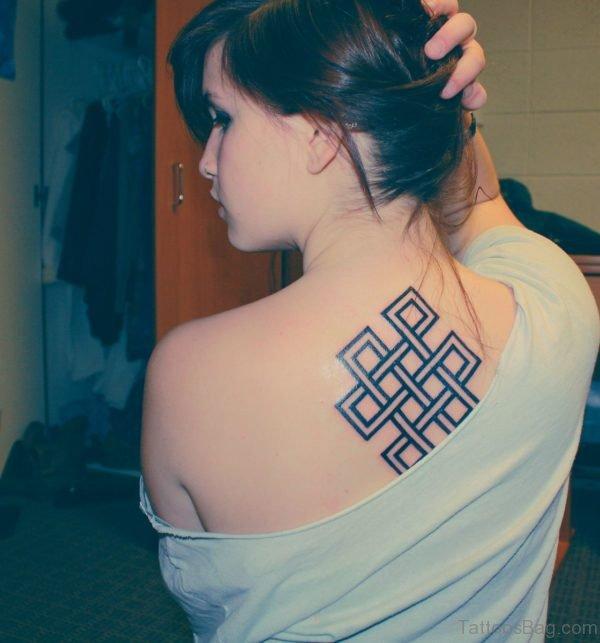 Awesome Buddhist Symbol Tattoo On Upper Back