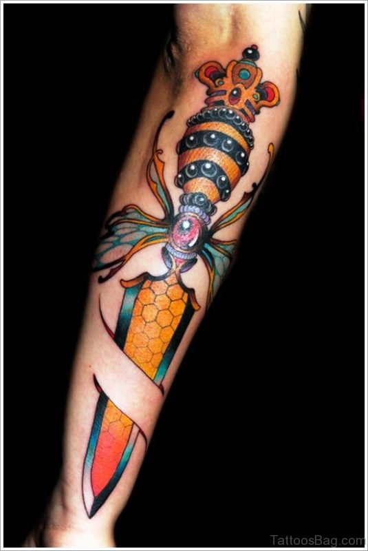 Awesome Colorful Dagger Tattoo On Arm