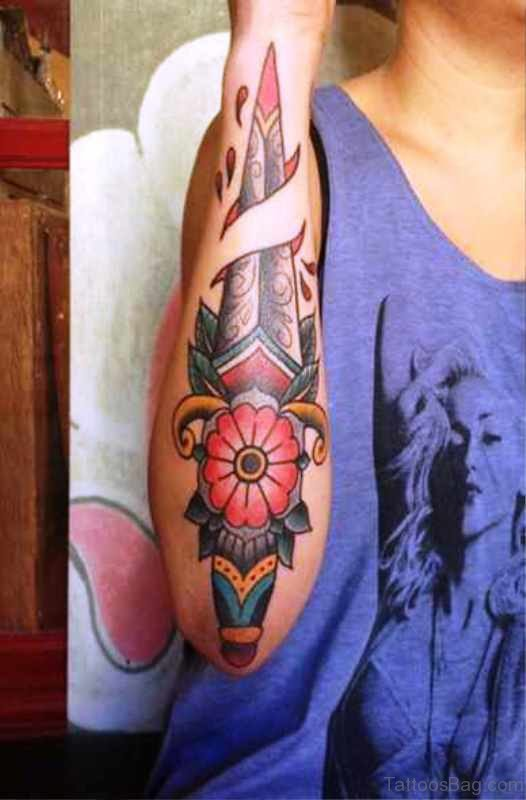 Awesome Dagger Tattoo On Arm