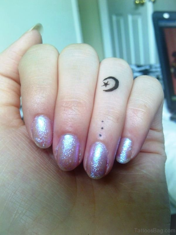 Awesome Moon And Star Tattoo On Finger
