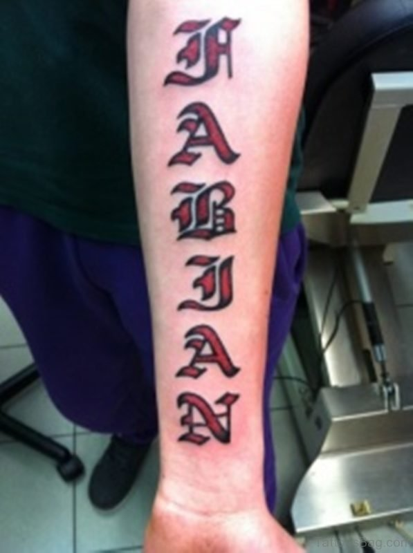 Awesome red colored massive ambigram tattoo on arm