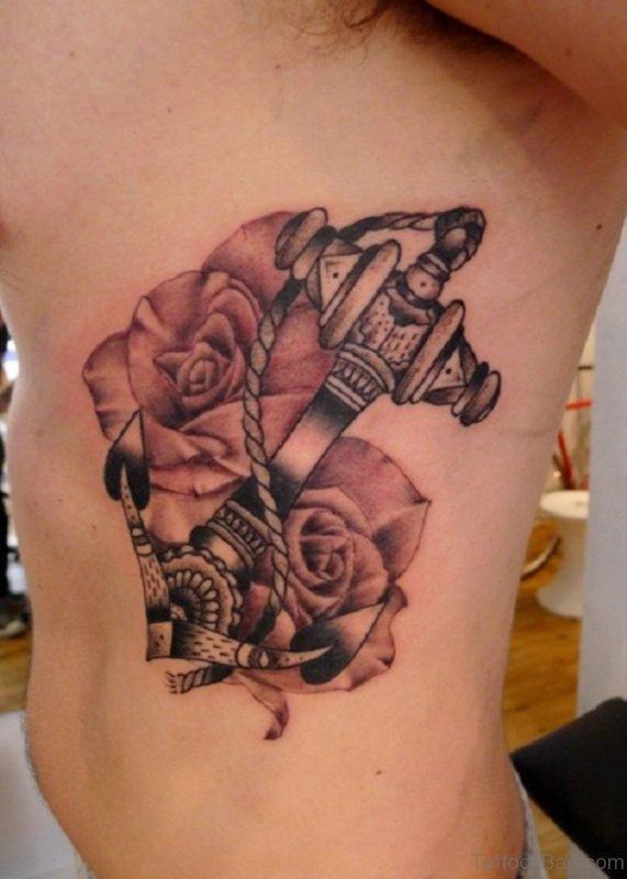 Balck Anchor And Rose Tattoo