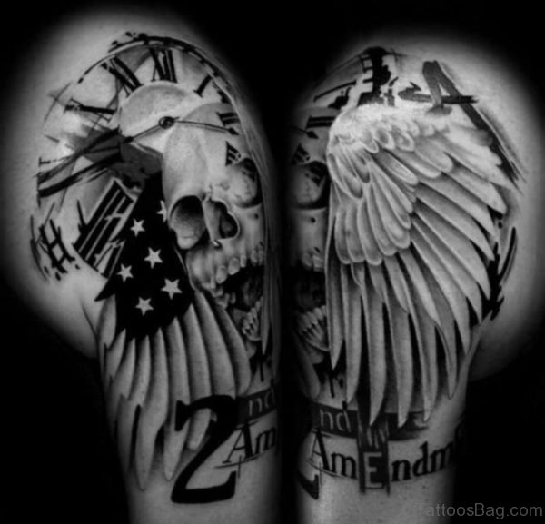 Black And White Skull Wings Tattoo