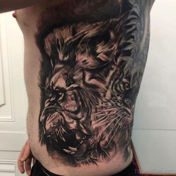Balck Lion Tattoo On Rib