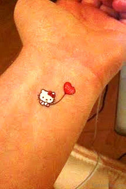 Balloon With Kitty Tattoo On Wrist
