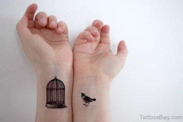 Beautiful Bird And Cage Tattoo On Wrist