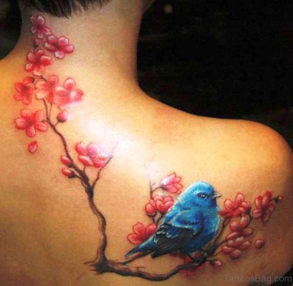 Beautiful Blue Bird And Blossom Flower Tattoo