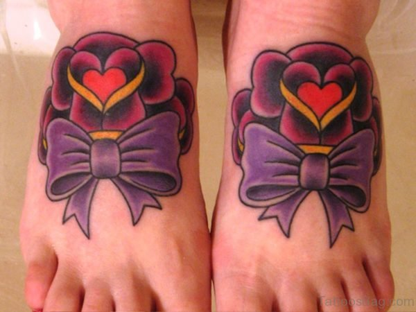Beautiful Bow Tattoo With Heart Design
