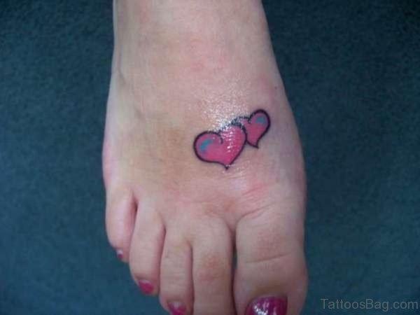 Beautiful Heart Tattoo Design On Foot