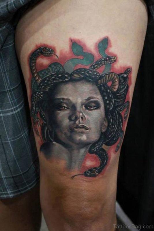 Beautiful Medusa Face Tattoo On Left Thigh