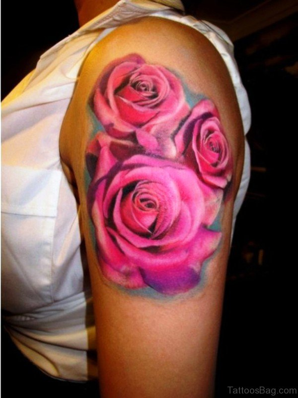 Beautiful Pink Flowers Tattoo On Left Shoulder
