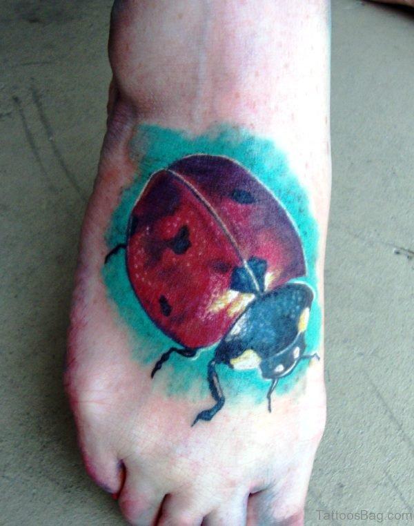 Big Red Ladybug Tattoo On Foot