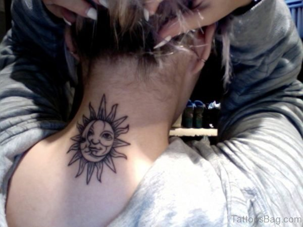Big Sun Face Tattoo On Neck Back