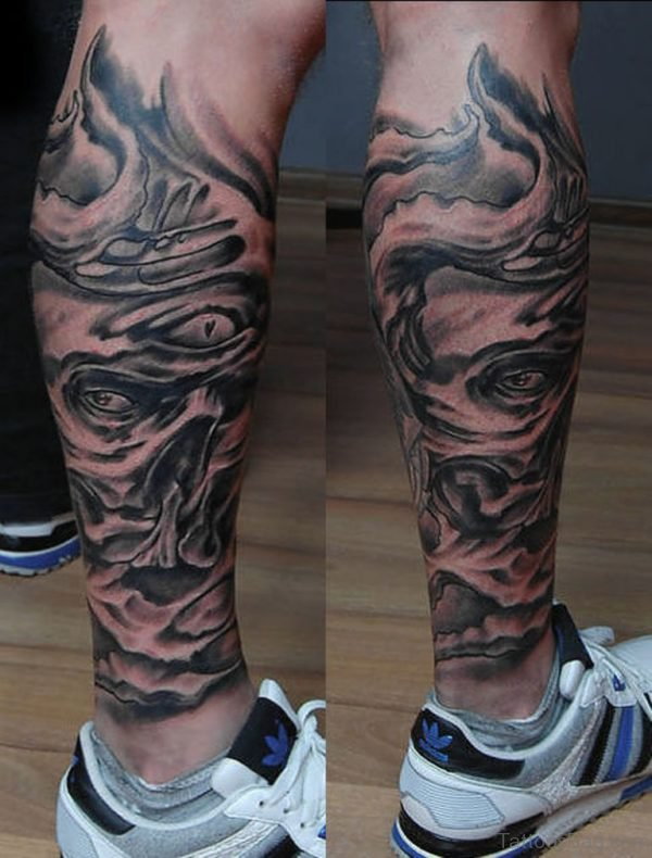 Biomechanical Face Tattoo On Leg