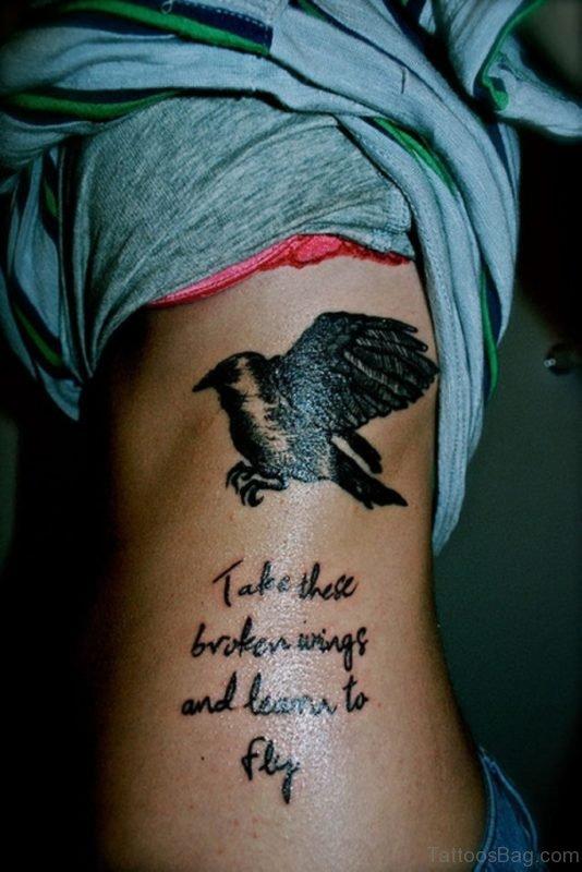Bird And Ambigram Wording Tattoo