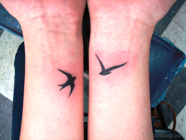 Birds Tattoos On Both Wrist Image