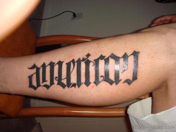 Black Ambigram Tattoo On Leg