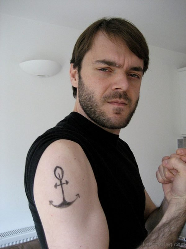 Black Anchor Tattoo On Right Shoulder