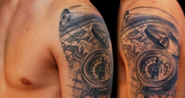 Black And Grey 3D Compass With Map Tattoo On Man Left Shoulder