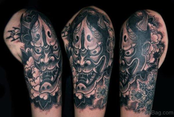 Black And Grey Hannya Mask Tattoo On Left Shoulder