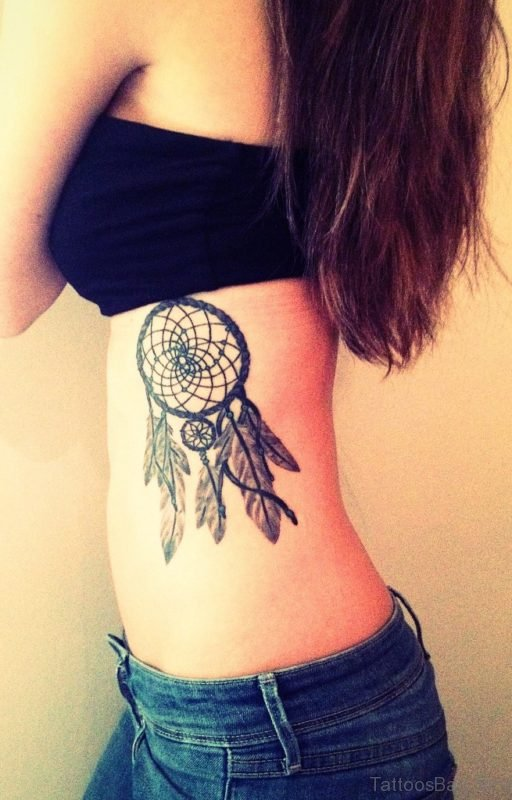 Black And Grey Ink Dreamcatcher Tattoo On Rib