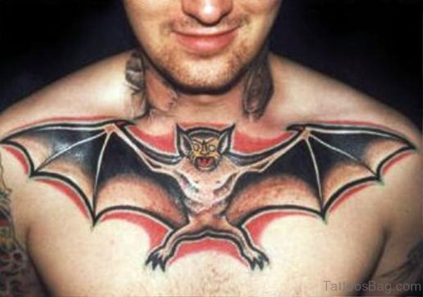 Black And Red Color Bat Tatoo On Chest