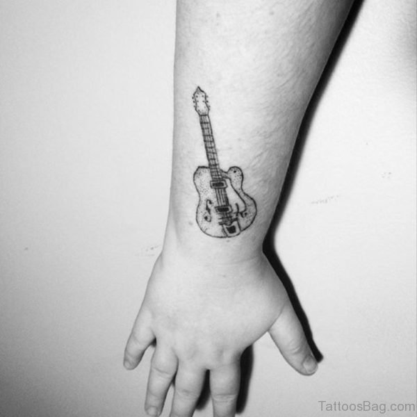 Black And White Guitar Wrist Tattoo