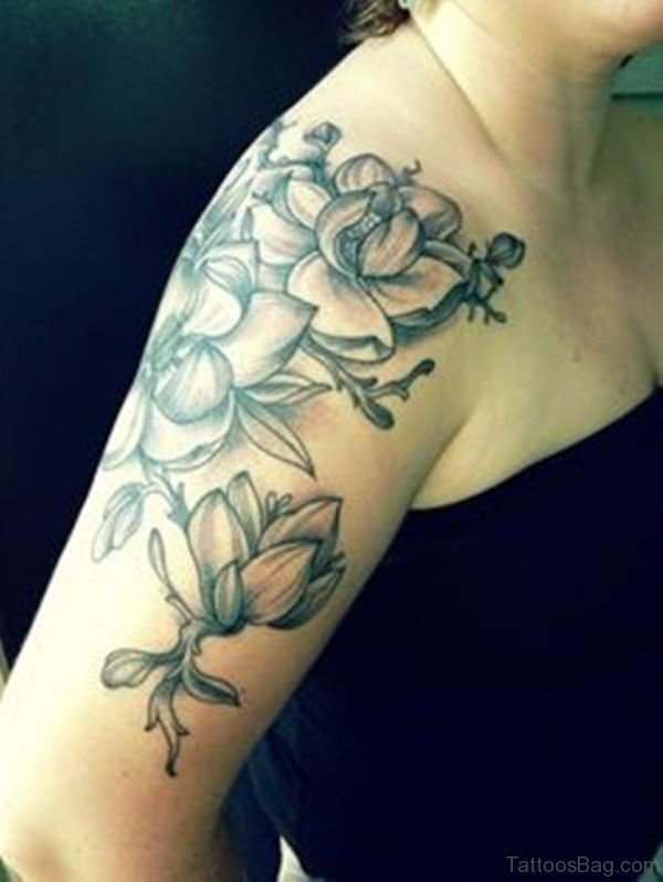 Black And White Magnolia Tattoo On Shoulder
